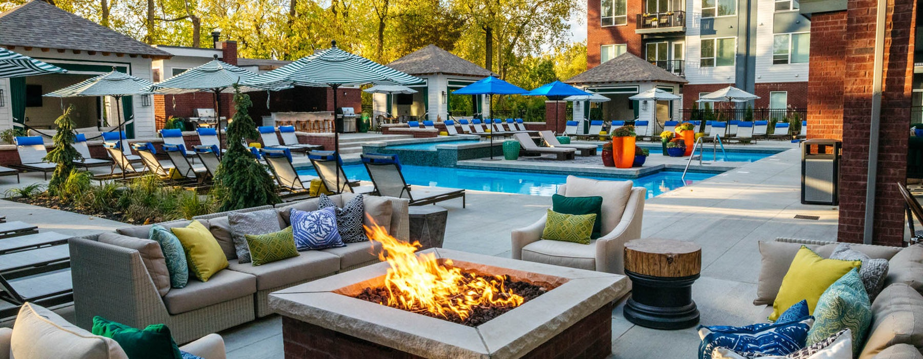 fire pit near outdoor swimming pool and covered cabana