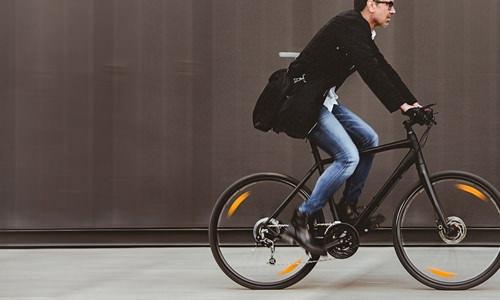 man riding to work on bicycle